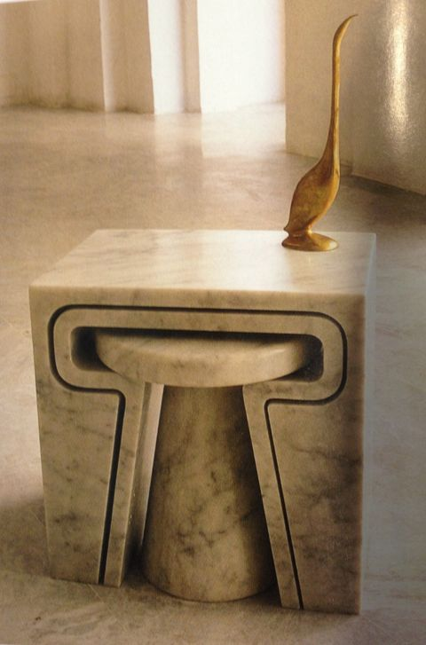 Marble nesting table by Jim Hannon-Tan. in the Jan 2013 issue of World of Interiors. I love the mix of materials here and the scale: solid, parchment coloured tables with the brass long necked bird. Their inherent qualities are so opposite that their differences makes them look better when seen together. (World of Interiors)