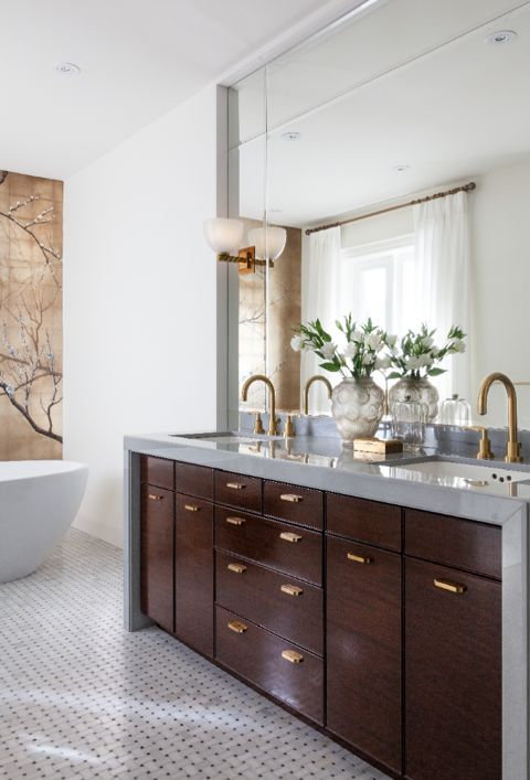 Custom designed mahogany vanity with stone counter and muted brass taps/hardware/sconces in master ensuite. (Casey Design/Planning Group Inc. - Photo by Donna Griffith)