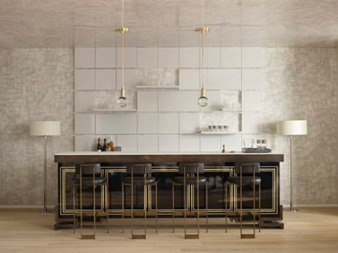 The great opportunity of loft spaces is the height and the chance to create drama, bold statements such as this grand brass and lacquer island. ( Habitually Chic )