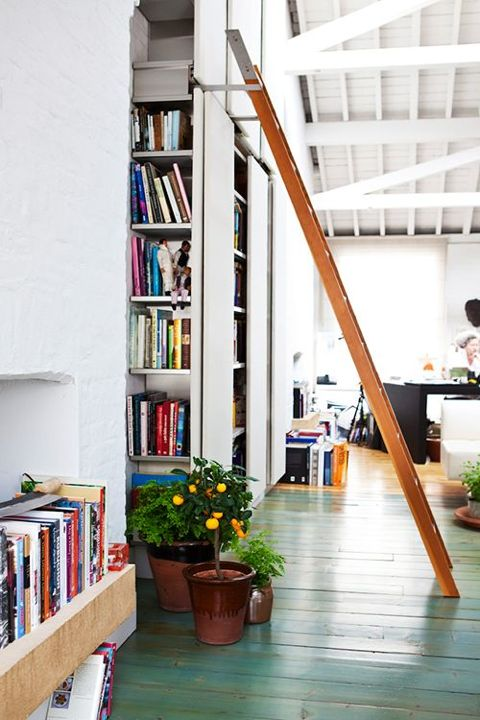 A Light-filled London Loft featuring a ladder to reach tall shelves - it's something that lots of us would love. There is something so romantic about it and I also love the green painted wood floors. (Bloglovin')
