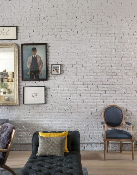 The brick walls have been painted and there is a hint of whimsy to the wide-open space that makes it very appealing. ( Remodelista )