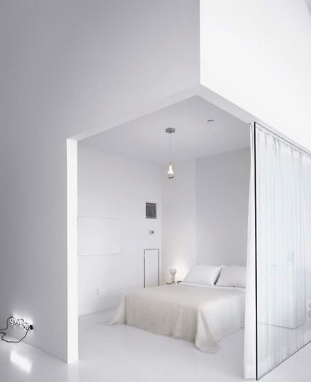 A dreamy minimalist design bedroom in white. The tall tall ceilings make this appealing as I don't usually like the split wall but I love the zen vibe. (Loftenberg)