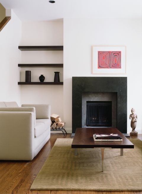 I did this project for a young entrepreneur over 10 years ago and it still has a classic enduring quality.  The clean, textured, sexy custom black lacquer fireplace brings focus, texture and drama to this contemporary living room. (Casey Design/Planning Group Inc. - Photo by Ted Yarwood)