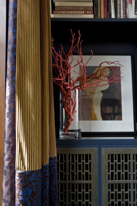 These Art Deco bronze screens were salvaged from the original Toronto Eaton's department store for my own home.  A great find, especially since the cabinetry had all ready been built and they fit perfectly! (Casey Design/Planning Group Inc. - Photo by ted Yarwood)