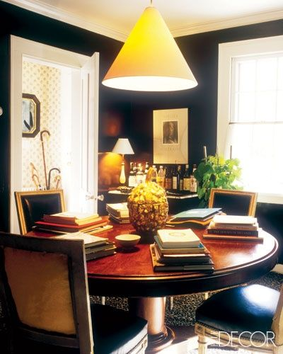 Love this cozy library/dining room featuring black walls ( Elle Decor ).