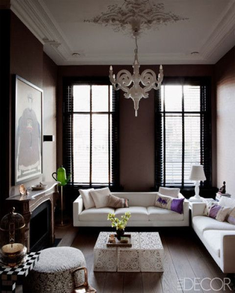 Living room: love the black walls, contrasted with the wife sofas and fantastic, patterned coffee table ( Elle Decor ).