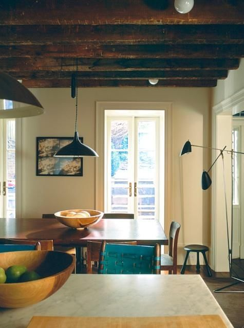 We love the subtle touches of indigo in this neutral kitchen. It beautifully complements the natural wood tones in the space.  ( Remodelista ).