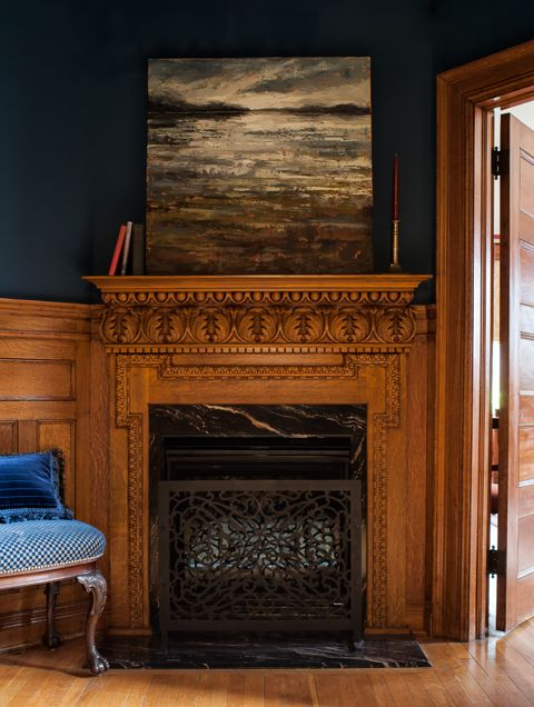 The rich hues of the indigo walls and the hand-carved, white oak mantle creates a foyer that looks like its been here for a hundred years. One of our favourite historical renovation projects.  (Casey Design/Planning Group Inc. - Photos by Ted Yarwood).