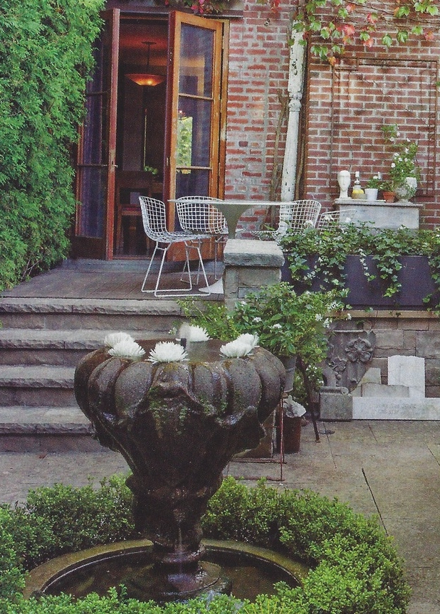 """An image of our finished urn water feature, as photographed by Donna Griffith in the May 2014 House and Home   article, """"A Creative Retreat""""."""