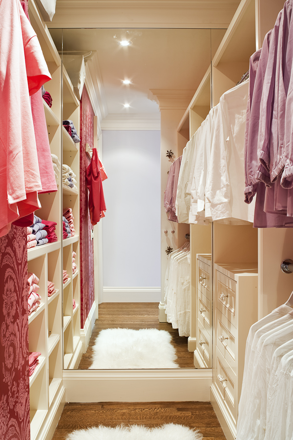 A floor to ceiling mirror is very useful in a walk-in closet. It also makes the space feel larger and more open. Bright task lighting allows our client to effectively use her closet space. (Casey Design / Planning Group Inc.- photograph by Ted Yarwood)