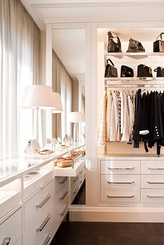 Open clothing racks above drawers makes this closet feel like a retail space. It allows key pieces to be displayed, while still allowing for plenty of storage and organization. ( West Coast Capri )