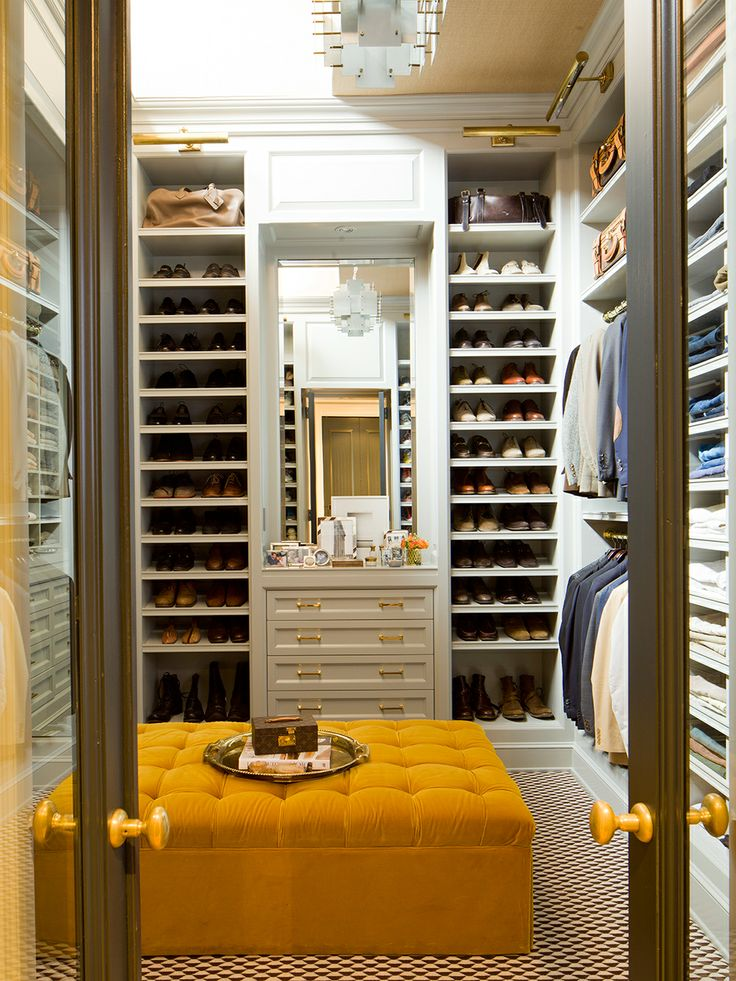 Open shelving in all areas of the closet allows for easy access to a wardrobe. Yellow details such as the ottoman and hardware create a sense of playfulness and character in the space. (Nate Berkus Designs)