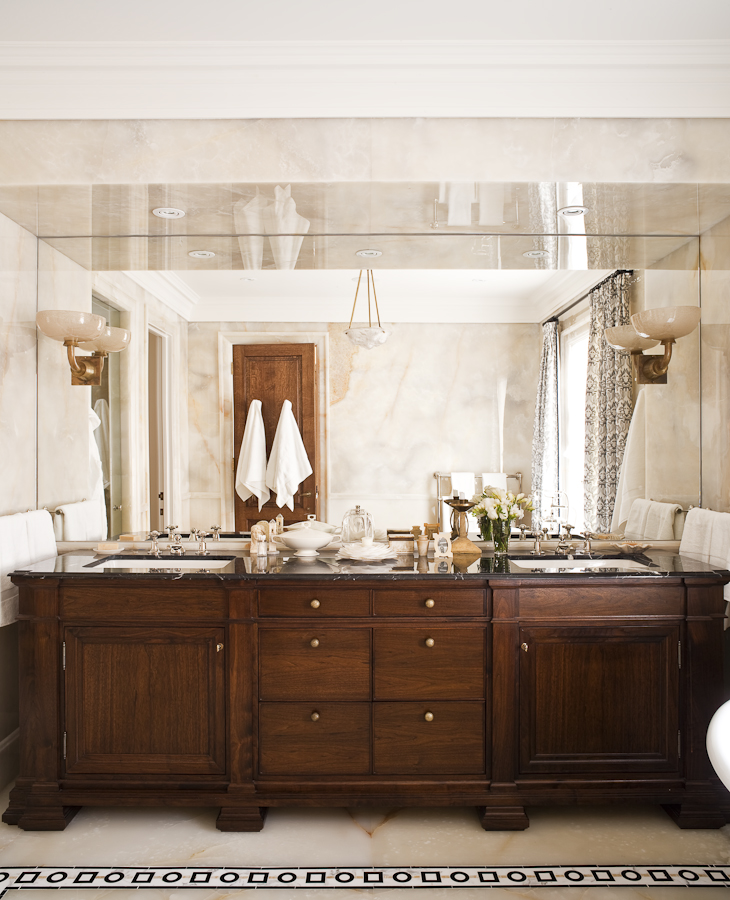 The faucets complement the custom walnut vanity and the 1920's glass sconces. (Photography by Ted Yarwood)