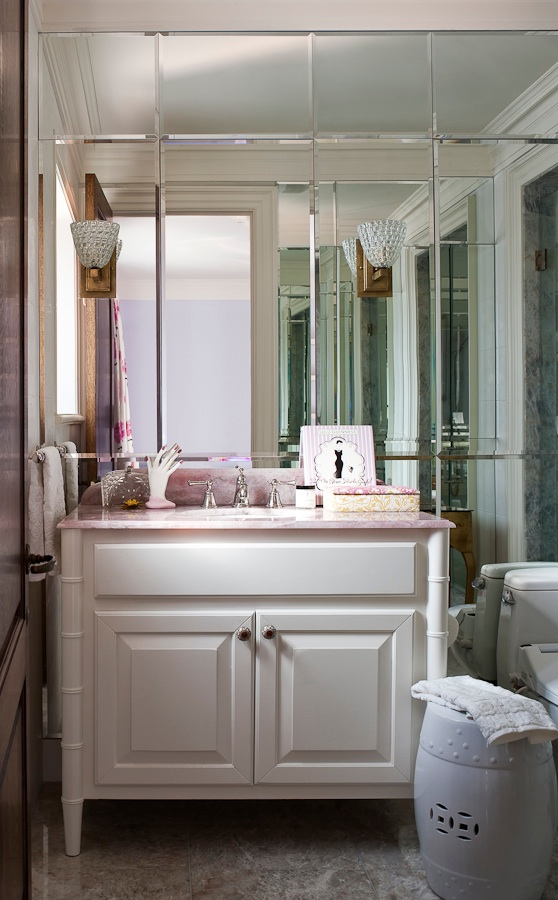 "In keeping with my philosophy of matching the design to the  person, this Ensuite design for my client's daughter was developed to appeal to her ""girly"" personality and her interest in fashion.  The pretty pink marble top with the clean,  white vanity is surrounded by floor to ceiling mirrors that hide storage for her make-up and accessories.  Any girl no matter what age would love this!"