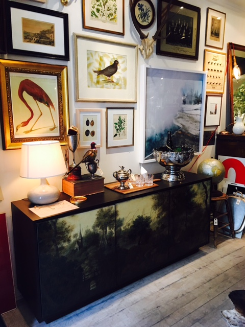Look at the salon style art and this amazing lacquer console.