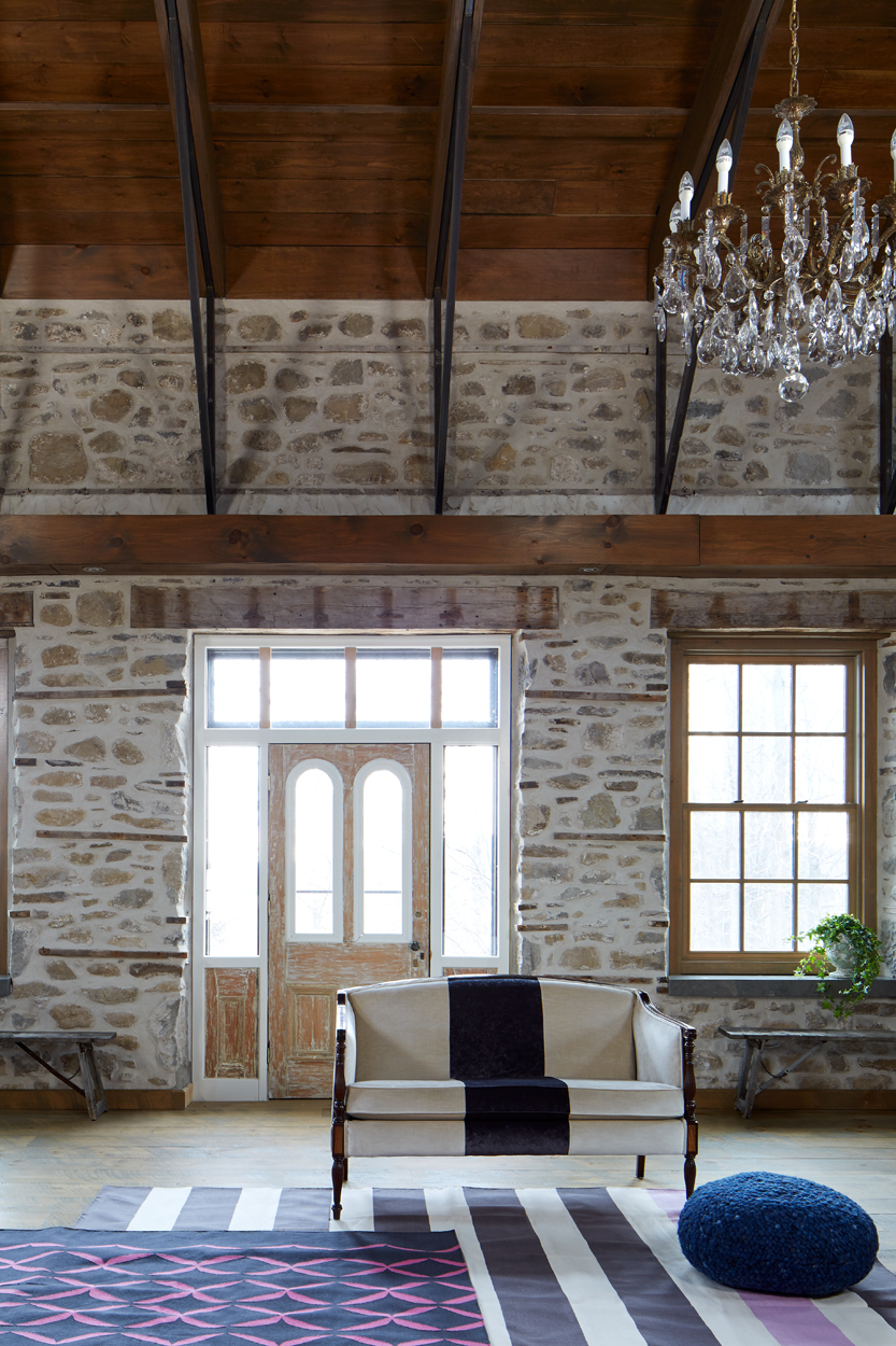 I love that this old, 1850s farmhouse was brought back from the ashes – literally and restored after the massive fire. We brought it up to now, to make it work for this family. It takes advantage of modern materials and methods, but speaks to the past, the family's as well as to Ontario history.