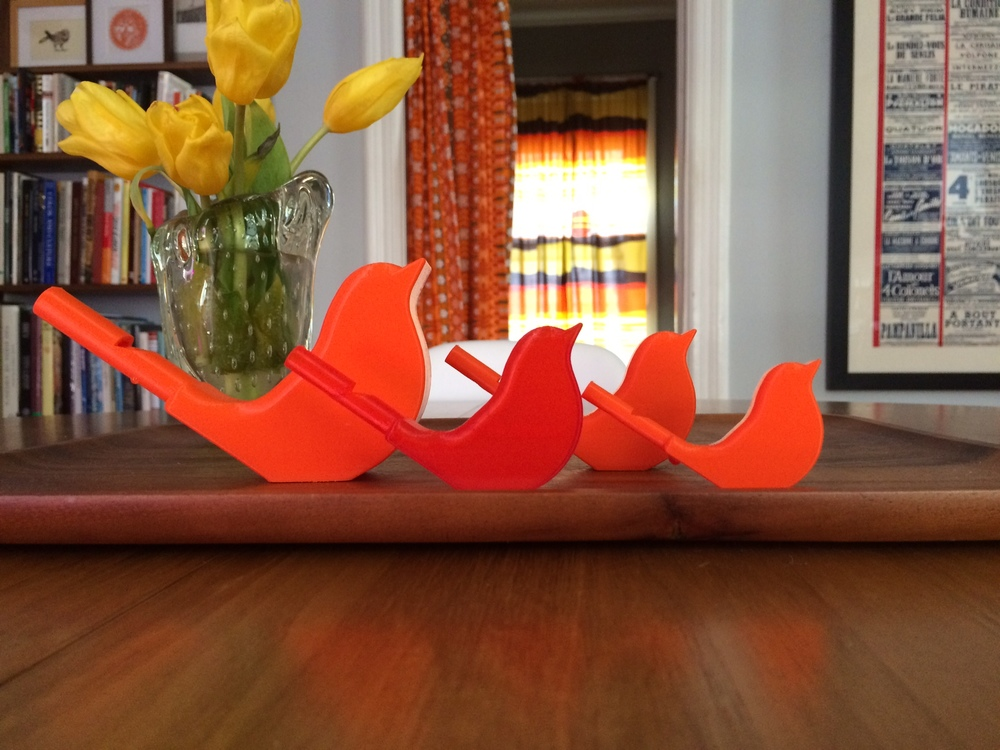 Three sizes, two prototypes and two originals, of the chirping bird whistles of Adam Stager. Just add water!