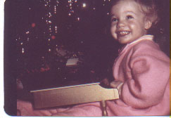 Big grin, pink pajamas, toy golden piano, Christmas morning, 1969.