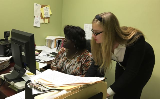 Staff paralegal Zakiya LaGrange (l) with intern Miranda Shaughnessy