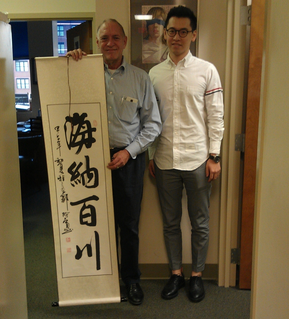 IMAG0427 - Linton Carney (PBP), Yifan Yang, with Yifan's sign gift that translates  All Rivers Run to the Sea.jpg