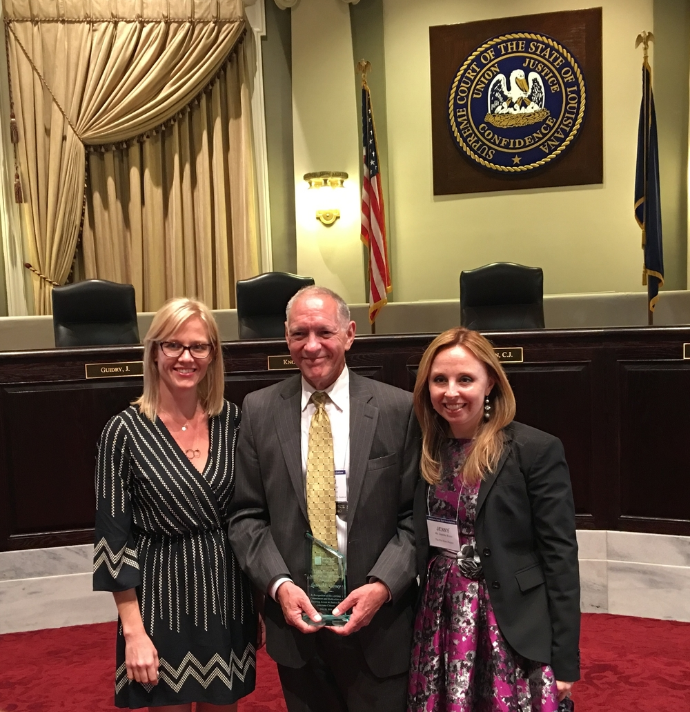 The Project's Chief Legal Officer Linton Carney (c) with Staff Attorney Ona Dudonis (l) and Executive Director Jenny Rizzo-Choi (r) at LSBA Pro Bono Awards on May 24