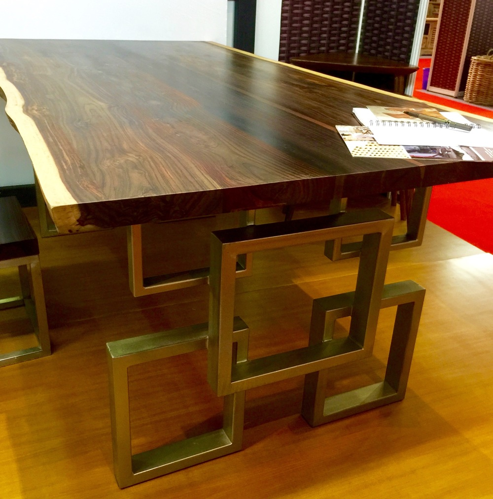 rose wood dining table with geometric metal legs
