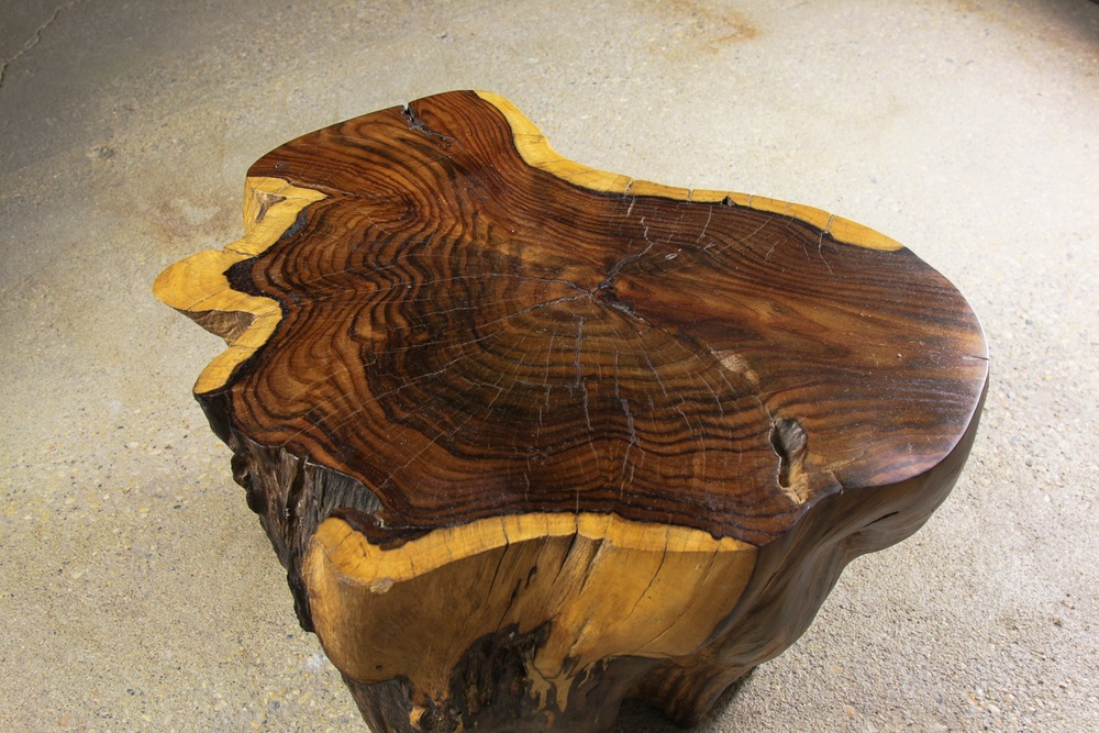 single slab free form authentically sculpted rose wood coffee table.