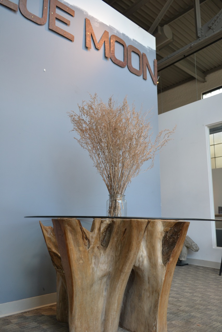 authentically sculpted teak root dining table with glass top