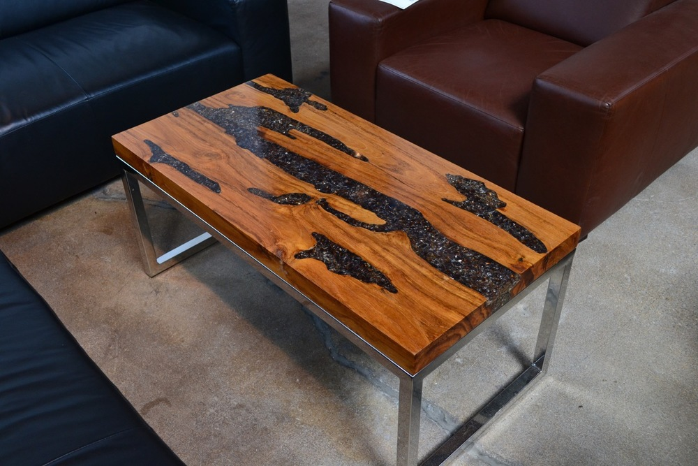 teak root and resin coffee table with stainless steel base