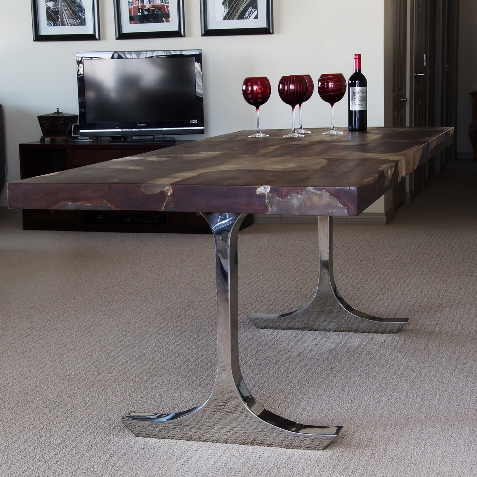 Teak Root and Resin Dining table with Stainless Steal Basehttp://www.bluemoonfurniture.ca/furniture-all-products/?category=Authentically+Sculpted