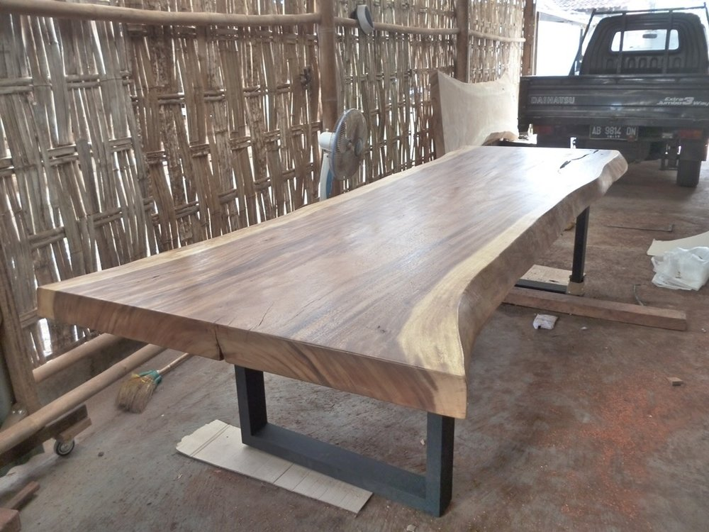 Live edge dining table with metal base. Modern furniture winnipeg.
