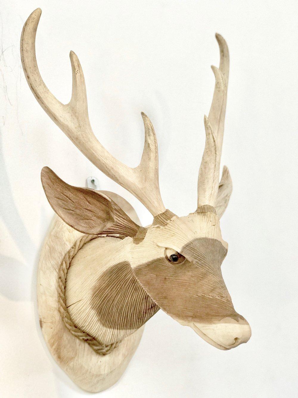 Rose wood deer head