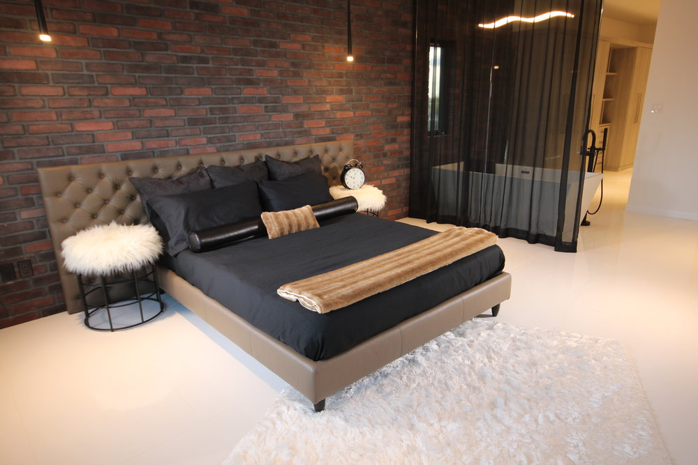 MCM leather tufted platform bed. artista show home. Blue Moon Furniture. Luxury furniture winnipeg.JPG