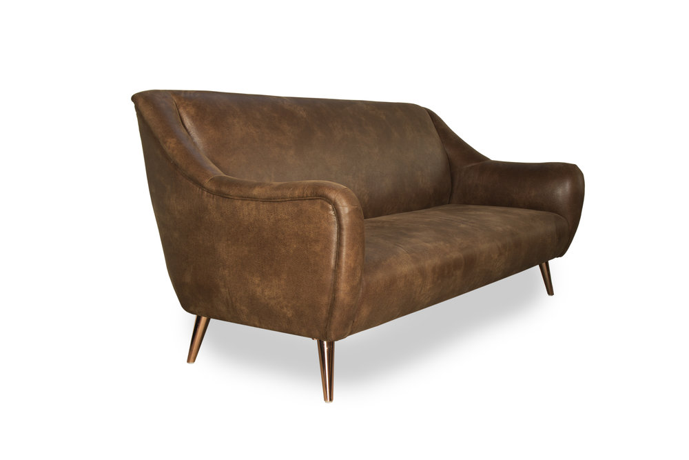 waterfront sofa with rose gold legs. Blue Moon luxury furniture store in Winnipeg