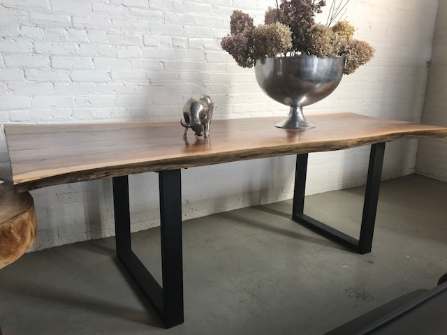 rose wood live edge dining table. with iron legs. Blue Moon Furniture store in Winnipeg.