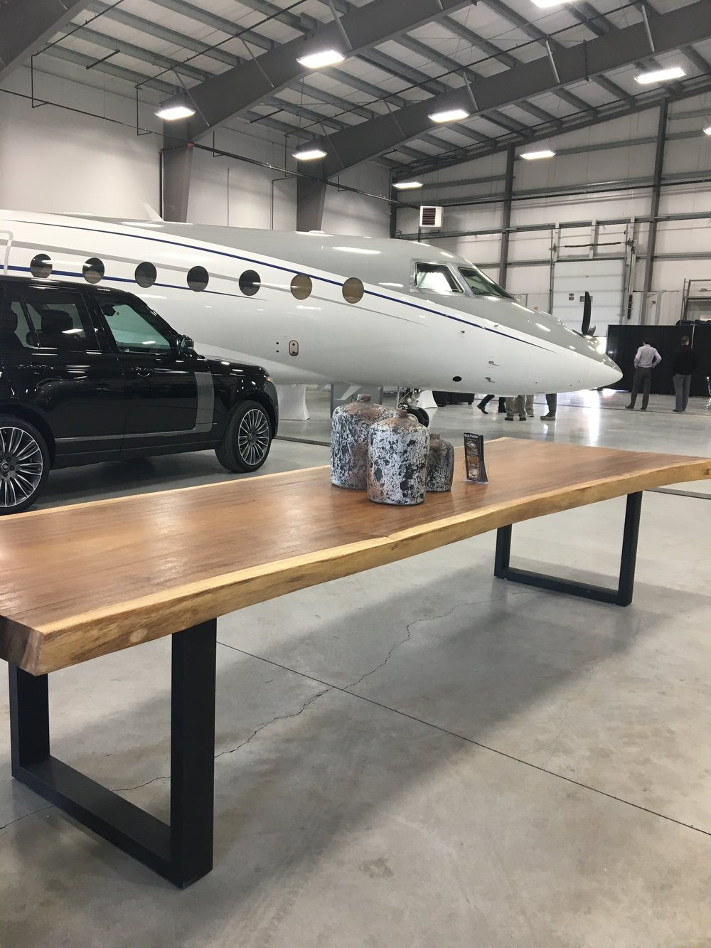 Majestic Live Edge Table from Blue Moon, Ranger Rover vehicle and Dassault Falcon private jet.