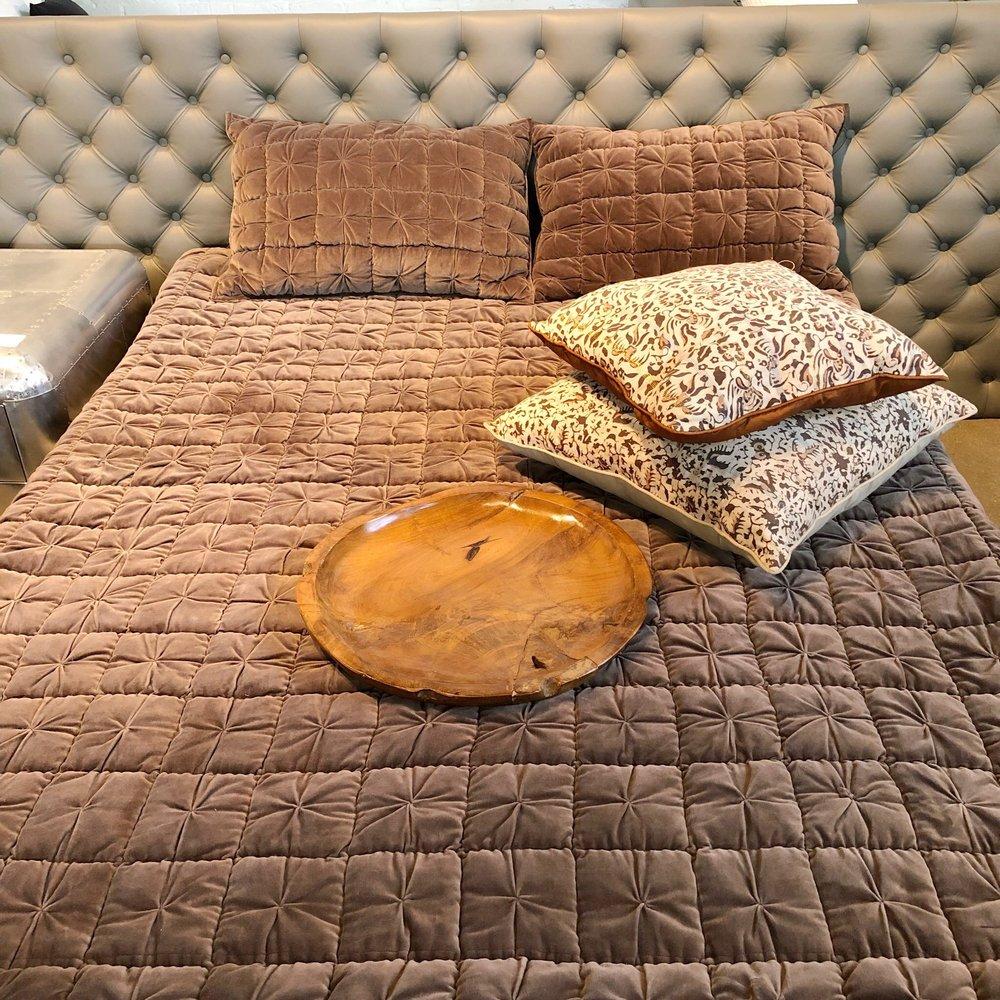 Upholstered platform bed. Leather tufted platform bed. Blue Moon Furniture store in winnipeg.jpg