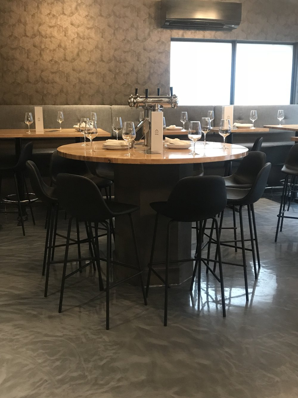 Blue Moon Furniture store in winnipeg. Commercial furniture. Carbone Coal Fired Pizza. Barstools.JPG