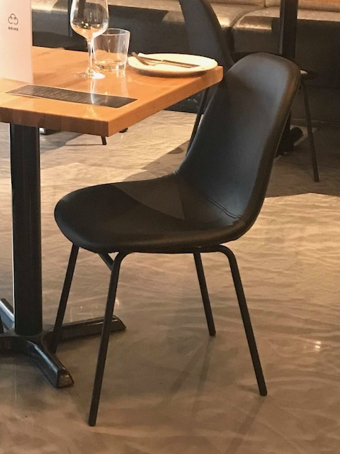 Blue Moon Furniture store in Winnipeg. Carbone Coal fired Pizza commercial furniture. leather chairs commercial.JPG