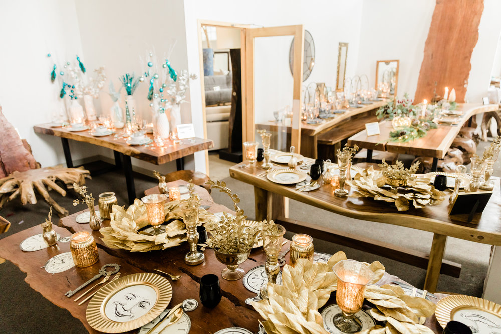 Gold themed holiday table setting on live edge dining tables