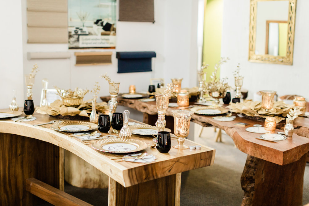 gold and black table settings for Christmas on a live edge dining table
