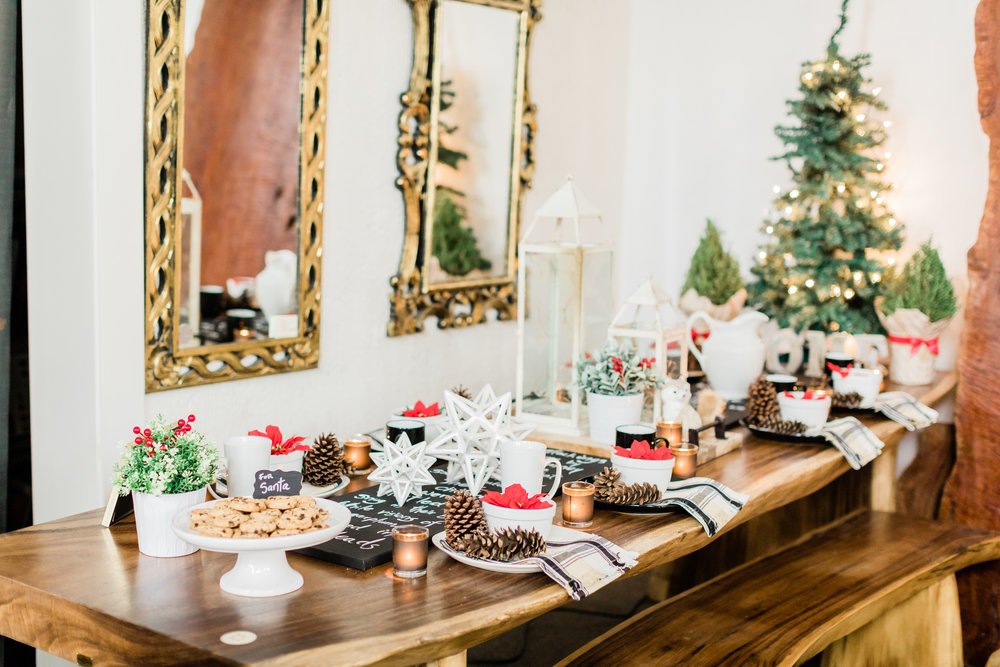 Live edge dining table scape with Christmas place settings.