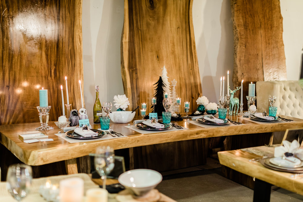 Table settings for Christmas on a live edge dining table.