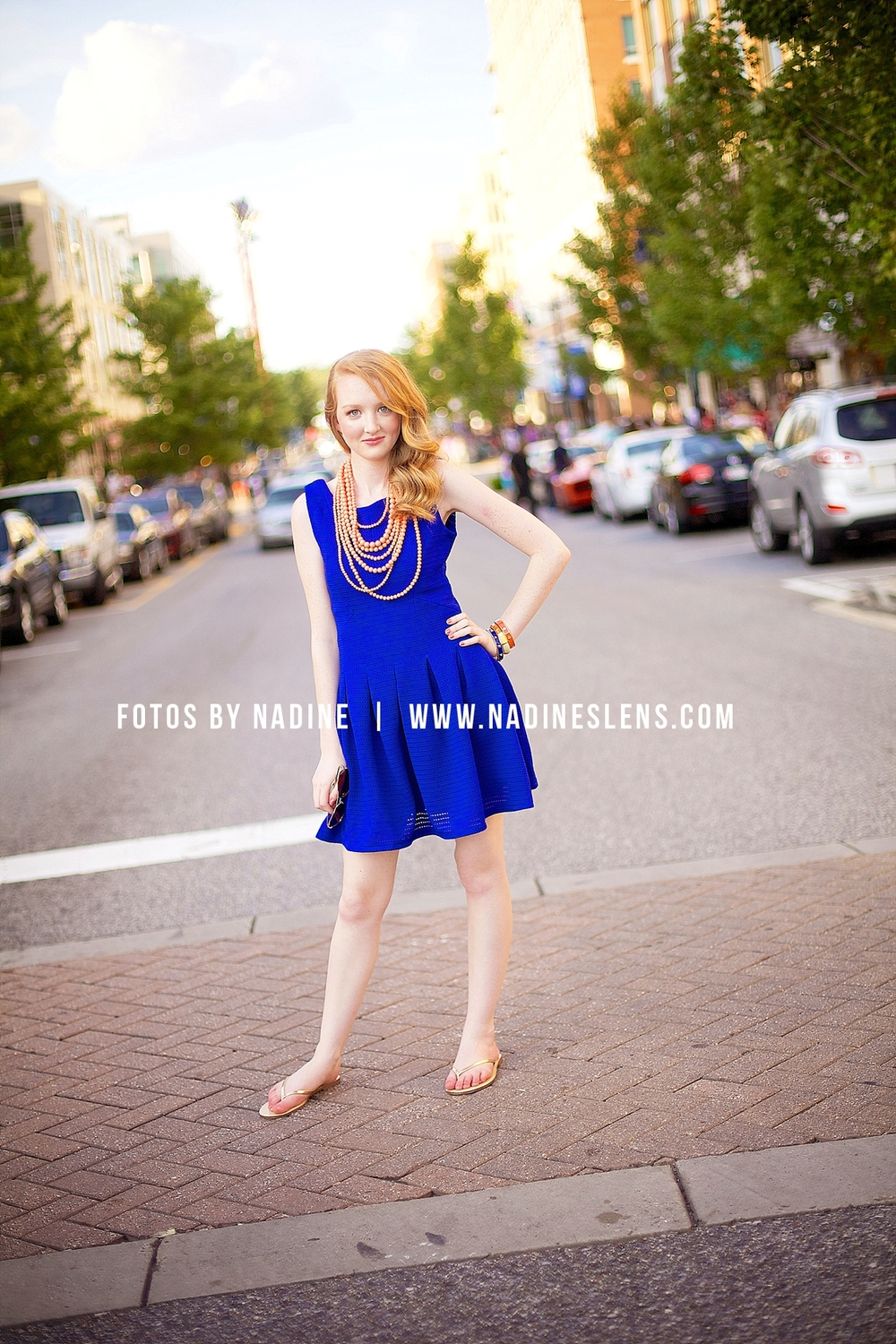 senior girl in blue dress and orange accessories from 3 sisters - fotos by nadine