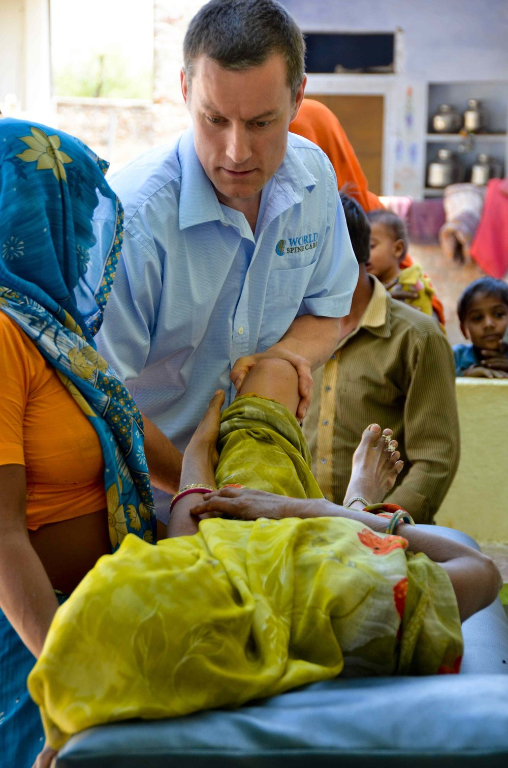 Dr. Geoff Outerbridge, World Spine Care Director of Clinics, treating a patient in India