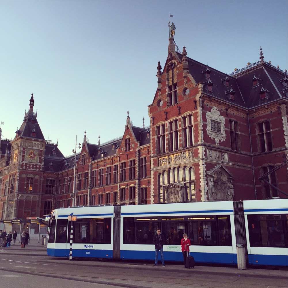 A tram in front of Amsterdam Centraal Station