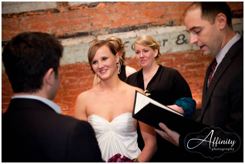 Bride and groom share glances during their ceremony.