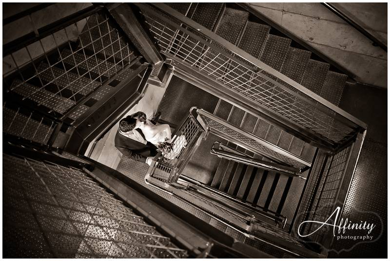 Bride and groom climbing the stairs together