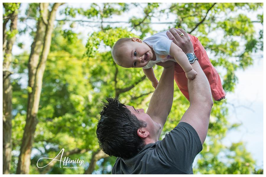 07-father-tosses-baby-in-air.jpg