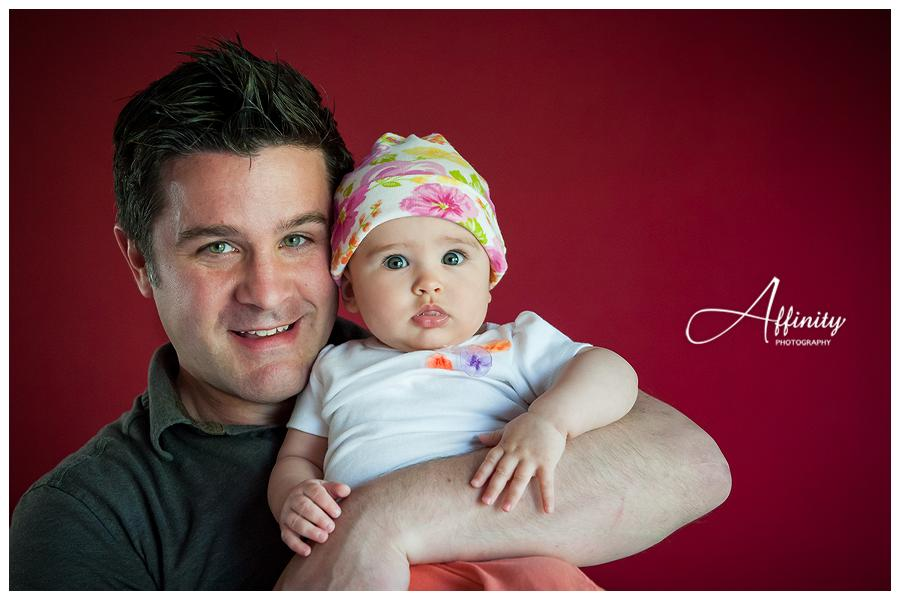 10-father-with-baby-daughter-red-wall.jpg